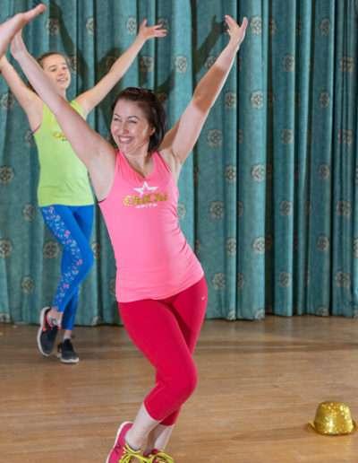 Woman following a dance workout