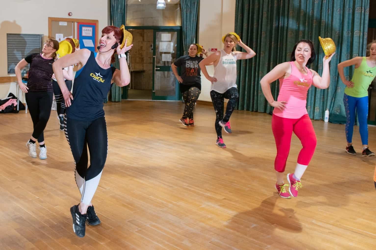 Musical Theatre Workout Routine with gold hats
